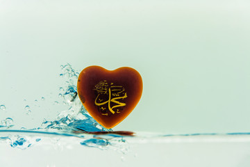 """muhammad "" prophet of Islam ( symbol ) Water splash with bubbles of air, isolated on the white background"