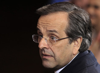 Greece's Prime Minister Samaras leaves the EU council headquarters after a European Union leaders summit discussing the European Union's long-term budget in Brussels