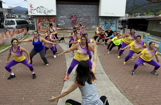 Andrea Abarca leads an aerobics class  in Los Guidos de Desamparados