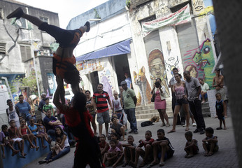 Artists from Coletivo Nopok circus group perform during the International Circus Festival in Providencia slum in Rio de Janeiro