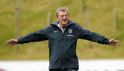 England's coach Hodgson stretches during a training session near Burton-upon-Trent