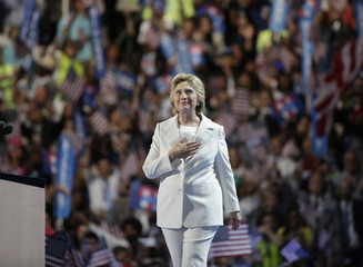 Democratic presidential nominee Hillary Clinton places her hand on her heart as she arrives onstage at the Democratic National Convention in Philadelphia, Pennsylvania