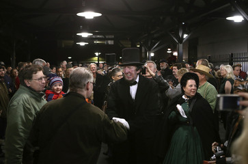 A re-enactor portraying Abraham Lincoln is welcomed at the Gettysburg, Pennsylvania train station