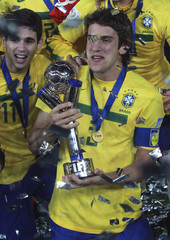 Brazil's players Bruno Uvini and Oscar celebrate with the trophy of the FIFA U-20 World Cup championship in Bogota