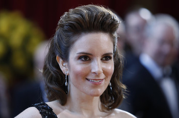 Actress Tina Fey poses upon arriving at the 82nd Academy Awards in Hollywood