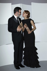 "Berenice Bejo, who won the Best Actress Award, poses with director Michel Hazanavicius, who won the Best Film Award, for the film ""The Artist"" after the 37th Cesar Awards ceremony in Paris"