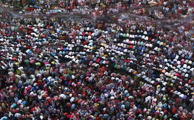 Protesters, opposing Egyptian President Mohamed Mursi pray during a protest demanding that Mursi resign at Tahrir Square in Cairo