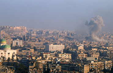 Smoke rises as seen from a government-held area of Aleppo