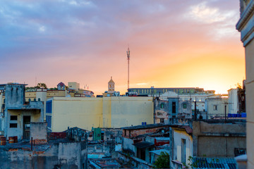 HAVANA, CUBA - APRIL 14, 2017: Authentic view of a abandoned house and street of Old Havana with amazing sunset
