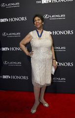 BET honoree Aretha Franklin poses at the red carpet during the BET Honors 2014 at Warner Theatre in Washington
