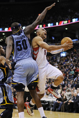 Toronto Raptors Jerryd Bayless goes to the basket against Memphis Grizzlies Zach Randolph during the second half of their NBA basketball game in Toronto