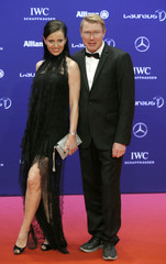 Former Formula One World Champion Hakkinen of Finland and his partner arrive for the Laureus World Sports Awards 2016 in Berlin