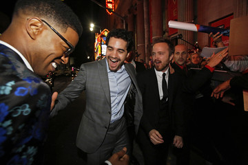 "Cast members Paul, Rodriguez and Mescudi greet each other at the premiere of ""Need for Speed"" at the TCL Chinese theatre in Hollywood"