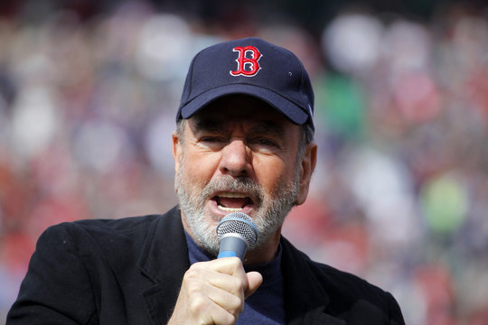 """Neil Diamond sings """"Sweet Caroline"""" during MLB American League baseball action between the Red Sox and the Royals in Boston"""