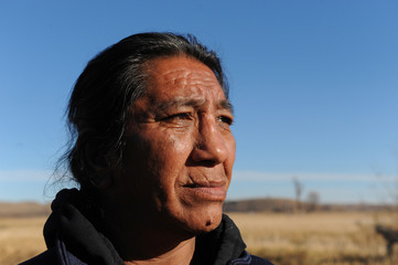 Rudell Bear Shirt, age 50, an elder from the Lakota Sioux tribe in Wounded Knee, South Dakota, poses for a photograph while camping at a protest against the Dakota Access pipeline near the Standing Rock Indian Reservation near Cannon Ball, North Dakota