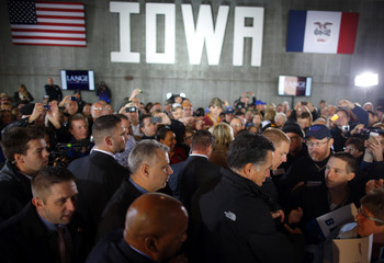 Republican presidential nominee Mitt Romney greets audience members at a campaign rally in Dubuque