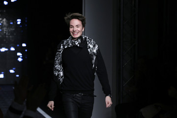 French designer Maxime Simoens appears at the end of his Fall/Winter 2014-2015 women's ready-to-wear collection show during Paris Fashion Week