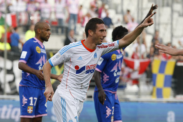 Olympique Marseille's Amalfitano celebrates after scoring a goal against Evian in their French Ligue 1 soccer match at the Velodrome Stadium in Marseille