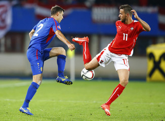 Moldova's Armas and Austria's Harnik fight for the ball during their Euro 2016 Group G qualification soccer match in Vienna