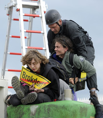 A German riot police climber removes anti-nuclear demonstrators during a blockade of the entrance of the nuclear power plant Brokdorf in Brokdorf
