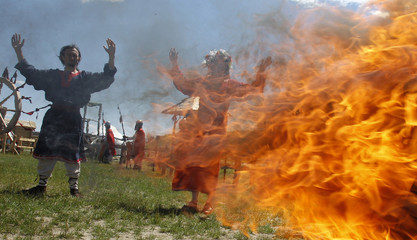 People dressed in historical costumes take part in theatrical pagan feast of the Sun and Fertility in Kopachev