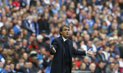 Manchester City's manager Roberto Mancini gestures during their FA Cup final soccer match against Wigan Athletic at Wembley Stadium in London