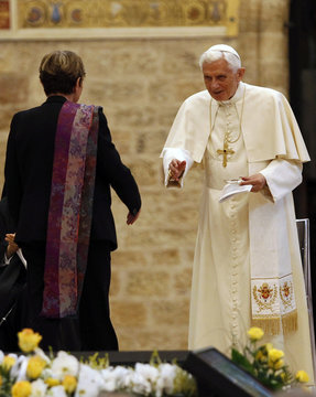 Pope Benedict XVI greets French literary theorist and linguist Julia Kristeva in Assisi