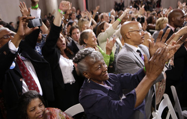 Supporters cheer as U.S. President Obama speaks at a campaign fund raising event in Philadelphia