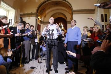 House Republican Leader John Boehner listens while Transition Chairman Greg Walden speaks during a media availability in Washington