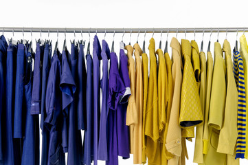 Variety of colorful female yellow and blue clothing on hanging