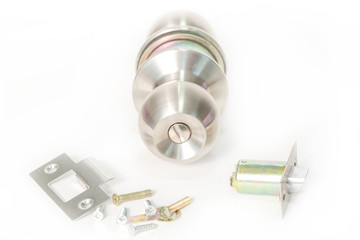 Stainless steel round ball door knob components isolated on the white background as Locksmith concept.