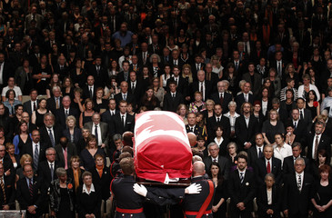 The coffin containing NDP Opposition Leader Jack Layton is carried away during his state funeral in Toronto