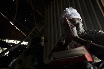 A woman prays at the Presbyterian Church in Pibor, South Sudan