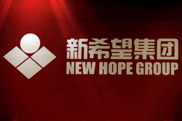 New Hope Group's logo is seen at its president Liu Yonghao's news conference in Beijing