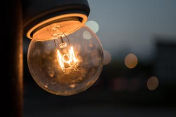 Glowing antique filament light bulb
