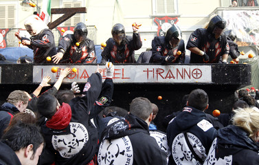 Members of a rival team fight with oranges during an annual carnival battle in the northern Italian town of Ivrea