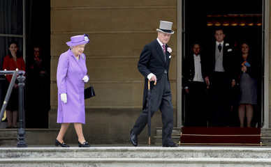 Britain's Queen Elizabeth and Prince Philip attend the first garden party of the season in the grounds of Buckingham Palace, London