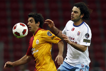 Galatasaray's Culio fights for the ball with Trabzonspor's Inan during their Turkish Super League soccer match in Istanbul