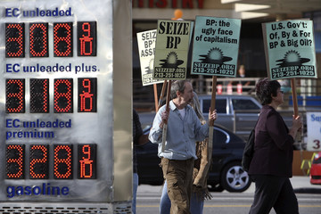 Protesters rally at the BP Green Curve ARCO gas station in Los Angeles during a national day of action against BP