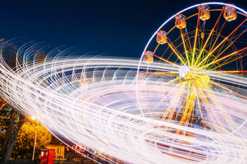 Rotating In Motion Effect Illuminated Attraction Ferris Wheel On