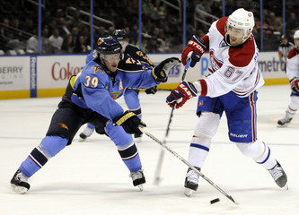 Montreal Canadiens left wing Max Pacioretty takes a shot on goal as Atlanta Thrashers defenseman Tobias Enstrom defends in their NHL game in Atlanta