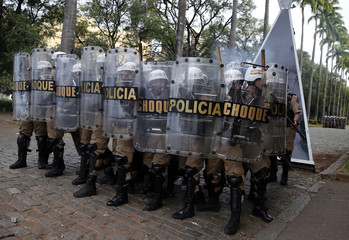 Police officers take their positions during a protest against the 2014 World Cup in Belo Horizonte