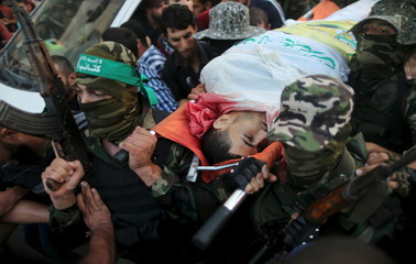 Palestinian Hamas militants carry the body of Farahat who was killed by Israeli troops in clashes, during his funeral in Gaza