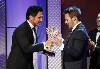 "Actor Diamont presents Clifton, who plays his onscreen son in the television series ""The Bold and the Beautiful,"" with the outstanding supporting actor in a drama series award during the 40th annual Daytime Emmy Awards in Beverly Hills"