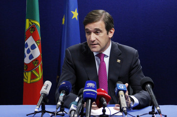 Portugal's PM Passos Coelho holds a briefing at the EU summit in Brussels