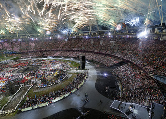 Fireworks explode over the Olympic stadium during the opening ceremony of the London 2012 Olympic Games