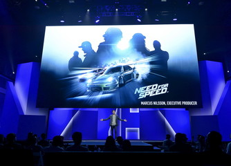 """Marcus Nilsson, Executive Producer for """"Need for Speed"""" video game speaks during Electronic Arts media briefing before the opening day of the E3, at the Shrine Auditorium in Los Angeles"""