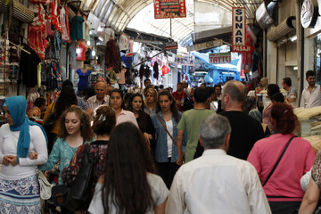 People shop in a shopping district in Hatay