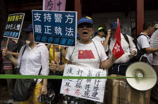 Supporters of The Voice of Loving Hong Kong, a pro-China group, shout  during a march to demonstratie against the so-called Occupy Central protest movement in Hong Kong