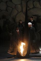 Kenya's Prime Minister Raila Amollo Odinga rekindles the eternal flame during a ceremony in Yad Vashem in Jerusalem